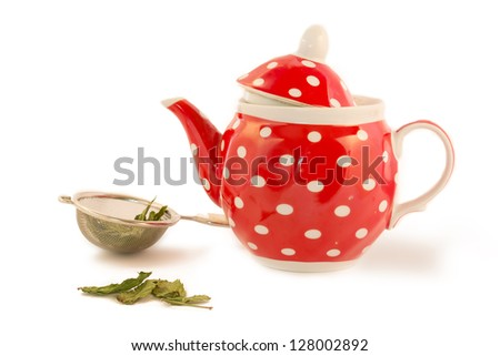 red kettle and tea leaves - stock photo