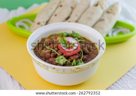 red kidney beans curry is a popular Indian vegetarian food consisting . Kidney beans are cooked in different spices. It is eaten with rice or wheat breads. - stock photo