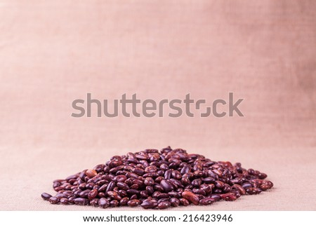 red kidney beans studio shot on flax - stock photo