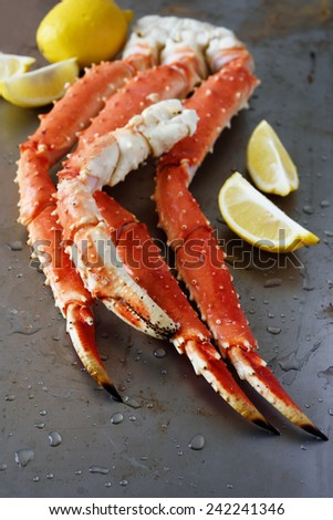 Red king crab legs with lemon - stock photo