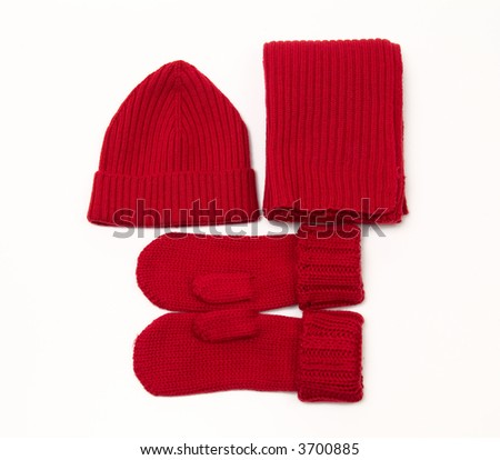 Red knitted cap, scarf and gloves - stock photo