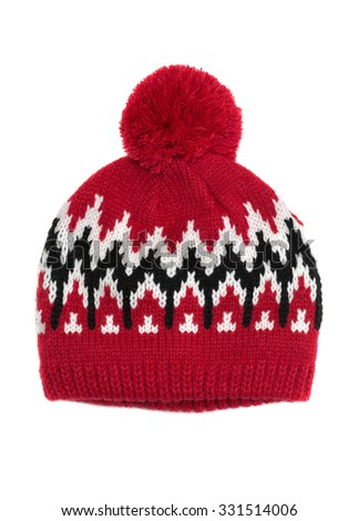 Red knitted cap with a pattern. Isolate on white. - stock photo