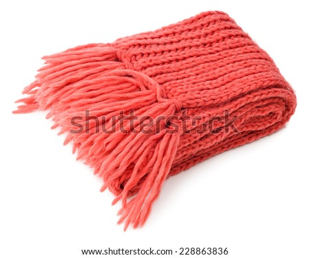 Red knitted scarf folded isolated on white background  - stock photo