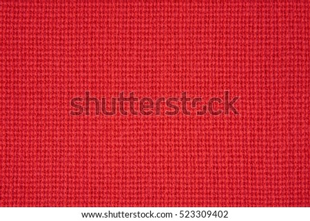 Red knitted wear as a seamless background