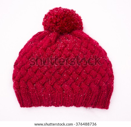 Red knitted wool hat - stock photo