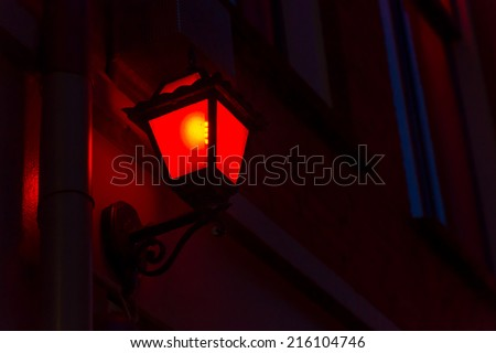 Red lantern on the wall in Red Light District in Amsterdam, Netherlands - stock photo