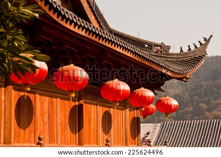 Red lanterns hanging on the temple roof/ Chinese lanterns in a chinese temple - stock photo