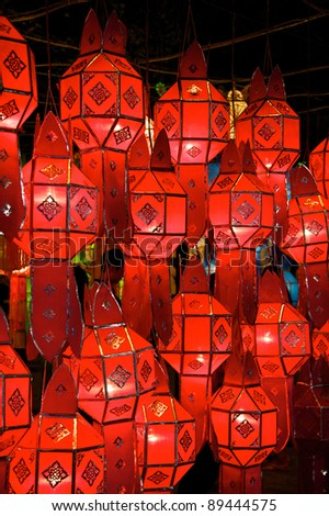 Red lanterns light up the streets in Chiang Mai, Thailand, for the Loy Krathong festival - stock photo