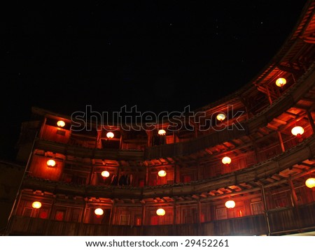 Red lanterns lighting the Chines old building in the Earth Tower of Hakka, Fujina, China. - stock photo
