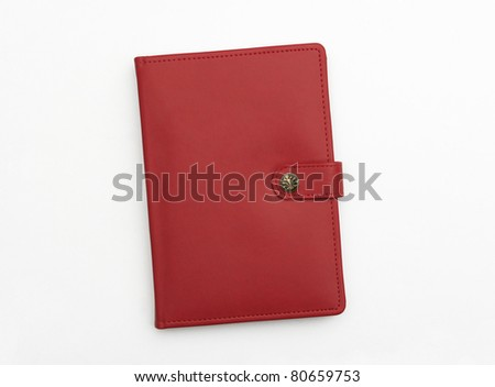 Red leather journal notebook diary isolated on white background - stock photo