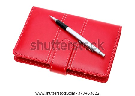 red leather notebook and ballpoint pen isolated on a white background - stock photo
