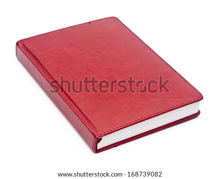 red leather notebook over white background