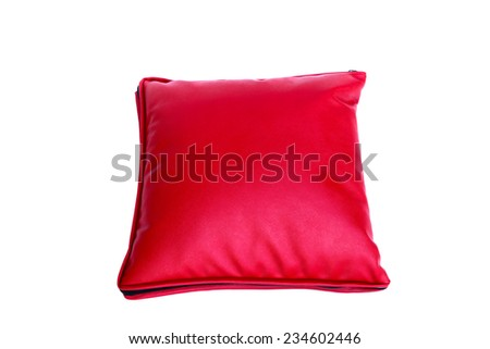Red leather pillow on white background - stock photo