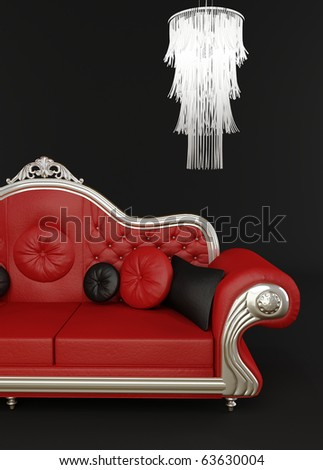 Red leather sofa with chandelier - stock photo