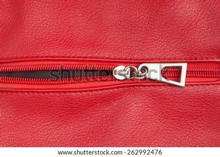 red leather texture with open zipper - stock photo