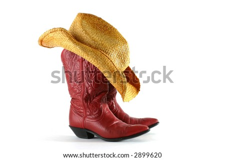 Red leather western boots with straw hat isolated on white - stock photo