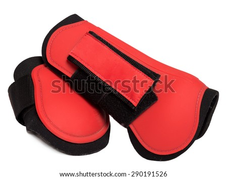 Red leg protectors for horse isolated on white - stock photo