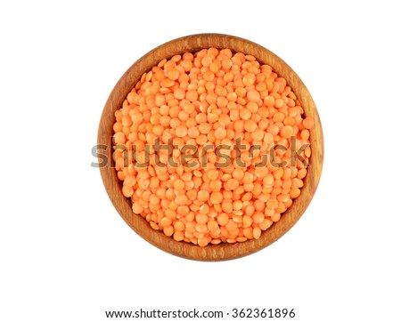 Red lentil in wooden bowl, isolated on white background - stock photo