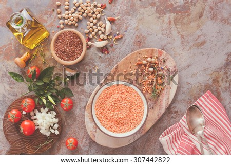 Red lentil soup with Chickpeas and Quinoa.   Red lentil soup with chickpeas, vegetable and spices  being prepared, top view - stock photo