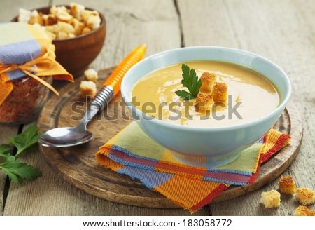 Red lentil soup with croutons in the bowl