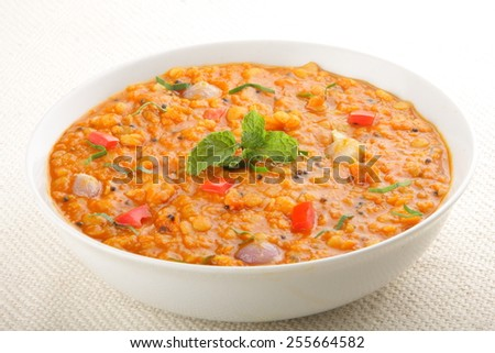 Red lentil soup with tomato and fresh herbs,Asian cuisine.with selective focus. - stock photo