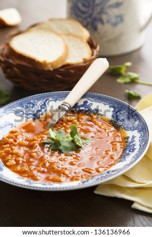 Red lentil, tomatoes and tamarind soup - stock photo