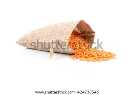 red lentils in burlap bag and heap of red lentils isolated on white background - stock photo
