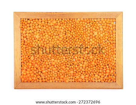 Red lentils in frame - stock photo