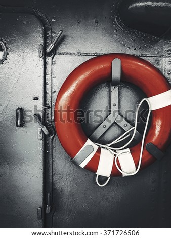 red lifebuoy hanging in ship - stock photo