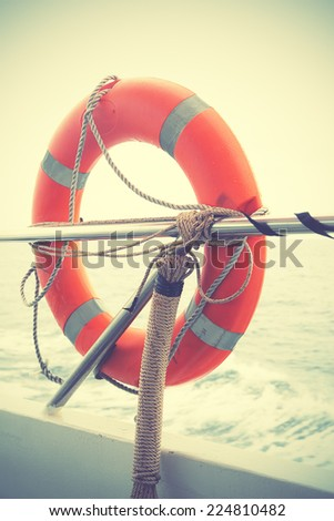 Red lifebuoy. Instagram style filtred - stock photo
