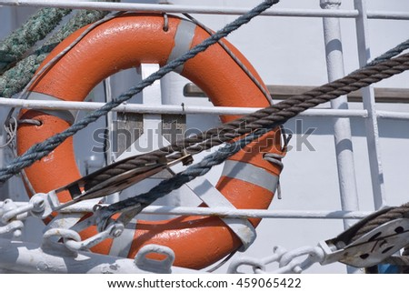 Red lifebuoy on the boat closeup photo in sunny day