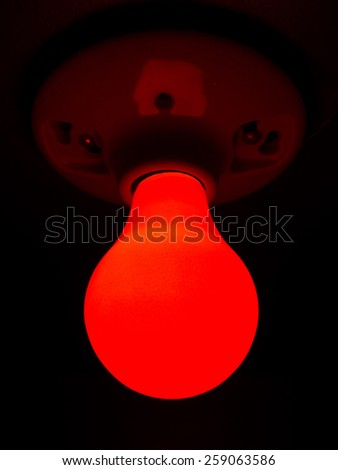 Red Light Bulb - stock photo
