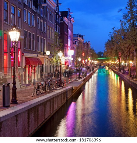 Red Light District in Amsterdam at night, North Holland, the Netherlands. - stock photo