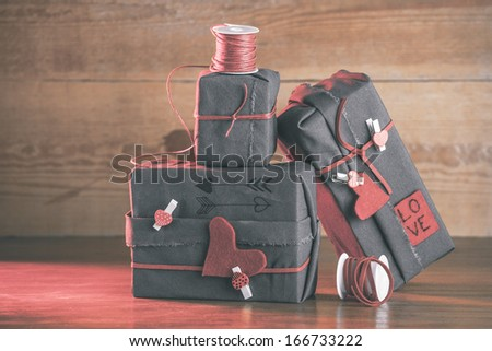 Red light on a wood background./ Valentines gifts box with hipster ornaments.  - stock photo