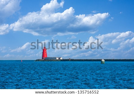 Red lighthouse and pier in the Dublin Bay in Ireland - stock photo