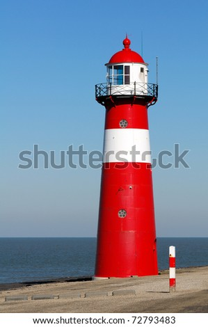 Red lighthouse in Zeeland, Netherlands - stock photo