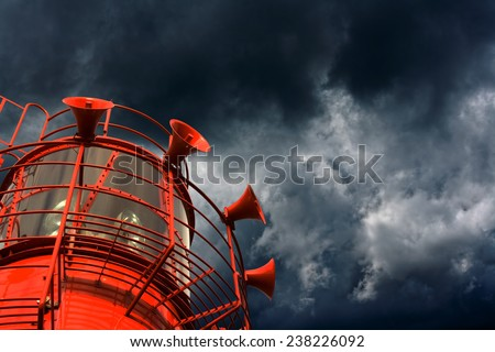 Red lightship with fog horns against storm clouds - stock photo