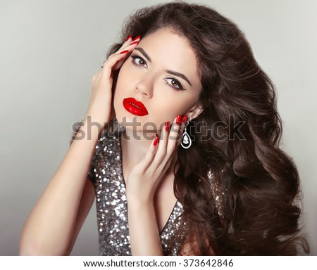 Red lips Beauty Makeup. Hair. Beautiful girl portrait. Brunette fashion woman with manicured nails, healthy curly shiny hairstyle posing on studio background. - stock photo