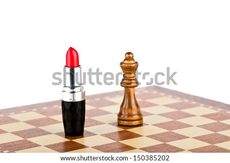 Red lipstick and a queen on a chess board