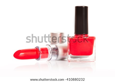 Red lipstick and nail polish on a white background - stock photo