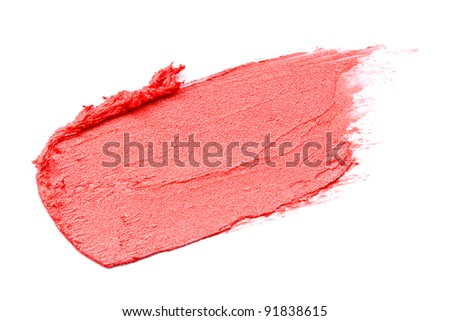 Red lipstick smeared on white background - stock photo