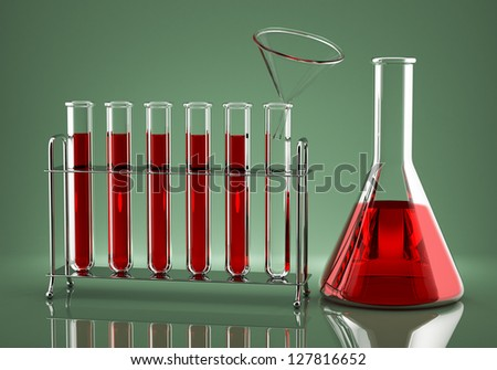 Red liquid is poured into the flask through a glass funnel - stock photo