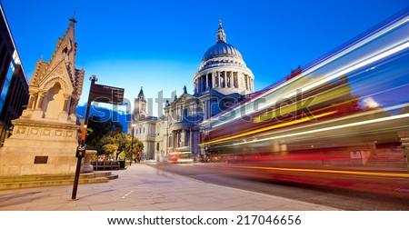 Red London bus in front of St Paul's Cathedral - stock photo