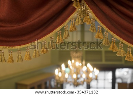 Red luxury curtain with bokeh.