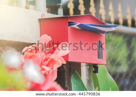 Red Mail Box in Front of a House - stock photo
