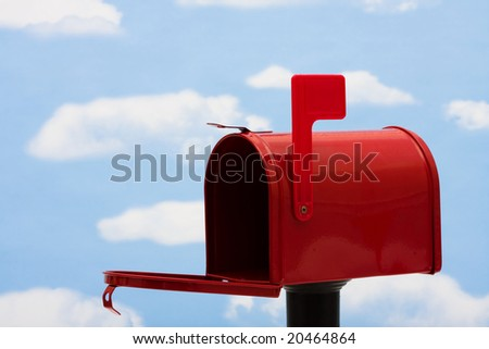 Red mailbox filled with a blue sky and cloud background, mailbox - stock photo