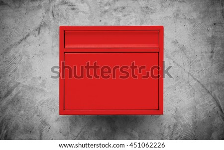 Red mailbox on concrete wall - stock photo