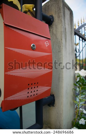 Red mailbox, Post box, Red metal mailbox - stock photo