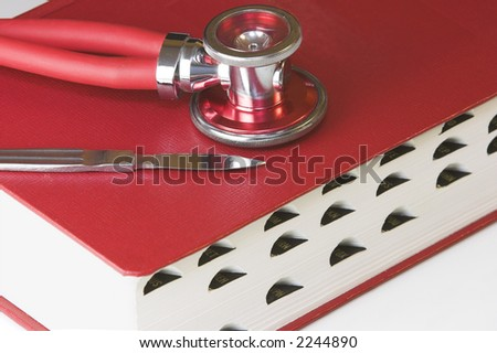 Red Manual with Stethoscope and Scalpel - stock photo