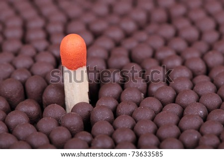 Red match over many brown matches, the leadership concept - stock photo